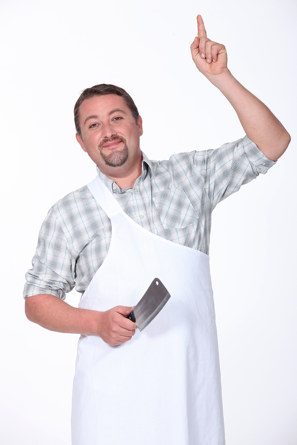 Butcher with hand raised